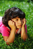 Girl on grass glancing — Stock Photo