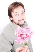 Hombre lindo con rosas — Foto de Stock