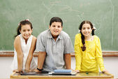 Three children in classroom — Stock Photo