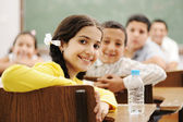 Happy cute children in classroom with their teacher — Stock Photo