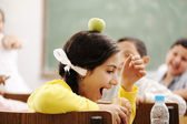 Children playing in classroom, happiness and togetherness with learning in — Stock Photo