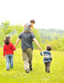 Happy family in nature, father and children walking — Foto Stock