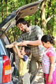 Family with car in nature — Stockfoto