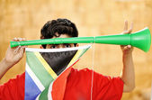 Encourager with vuvuzela and flag — Stock Photo