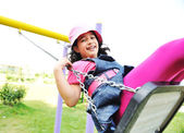On the playground, swinging — Stock Photo