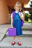 Blonde girl in front of the school standing — Stock Photo
