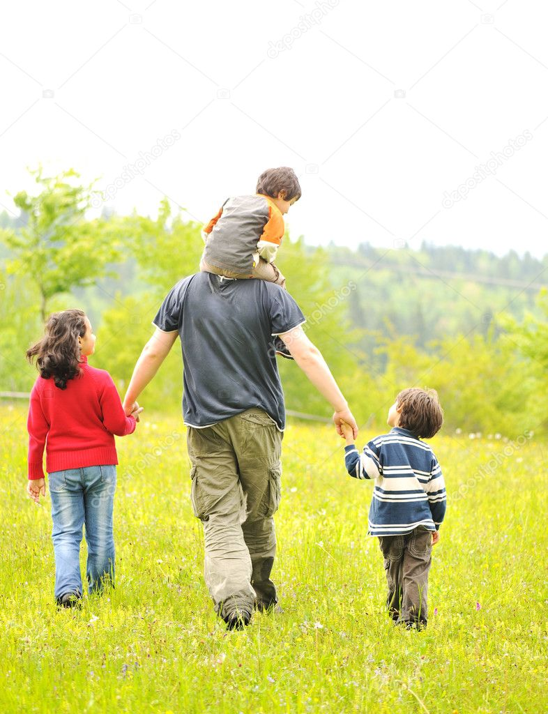 Happy family in nature, father and children walking — Stock Photo #6187765