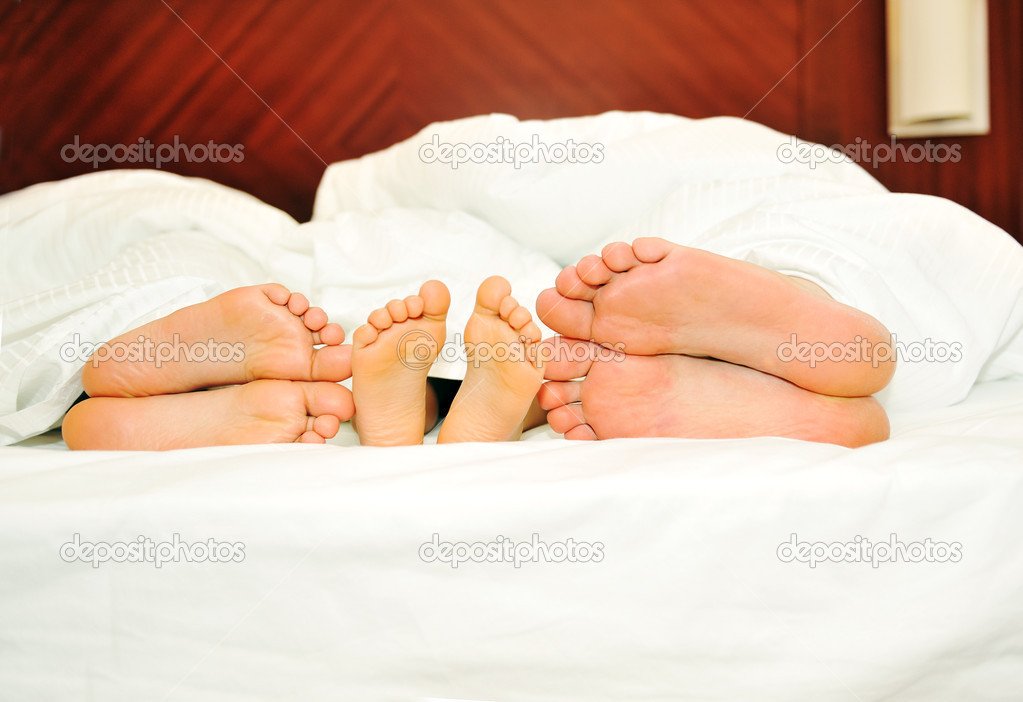 Happy family in bed, six feet  Stock Photo #6187948