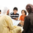 Education activity in Ramadan, Muslim couple and children reading Koran — Foto Stock