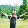 Happy father and son flying in forest — Stock Photo