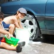 Playing around the car and cleaning, children in summertime — Stock Photo #6212746