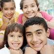 Vertical photo of children group, four friends smiling outdoor, boys and gi — Stock Photo