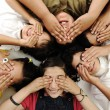 Happy children group lying and closing eyes by hands — Stockfoto #6212772