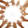 Conceptual symbol of multiracial children hands making a circle on white b — Stock Photo
