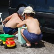 Playing around car and cleaning, children in summertime — Foto Stock #6212806