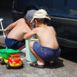 Stock Photo: Playing around car and cleaning, children in summertime