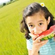 Eating watermelon outside — Stock Photo #6212827