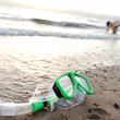 Snorkeling mask on the beach, children playing around — Stock Photo