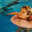 Little cute baby  girl  in blue water of the swimming pool, summer time for — Stock Photo