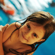 Little cute  girl  in blue water of the swimming pool, summer time for fun — Stock Photo