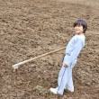 Little farmer working on the farm, child — Stock Photo