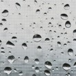 Natural big water drops on window glass - Stock Photo