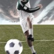Football player on field playing with a ball — Stock Photo #6213110