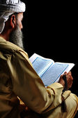 Muslim reading Koran — Stock Photo
