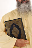 Muslim man, long beard, Koran in hand — Stockfoto
