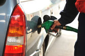 Man refilling the car with fuel on a filling station — Stock Photo