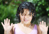 Splashing water in summer, cute girl playing outdoor in nature — Stock Photo