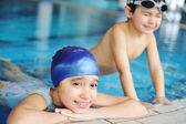 Children in blue water of the swimming pool, summer time for fun — Stock Photo