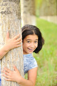 Girl in forest hiding — Stock Photo