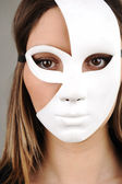 Portrait of a beautiful girl with white mask — Stock Photo