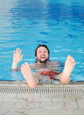Swimming man, fun in pool — Stock Photo