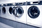 Washing machines in arow in a laundry — Stock Photo