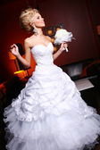 Young and beautiful bride in wedding dress — Stock Photo