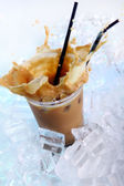 Cold coffee drink with ice and splashes — Foto de Stock