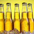 Glass of beer with foam on yellow background — Stock Photo