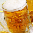 Glass of beer with foam — Stock Photo #5716734