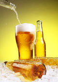 Beer is pouring into glass — Stock Photo
