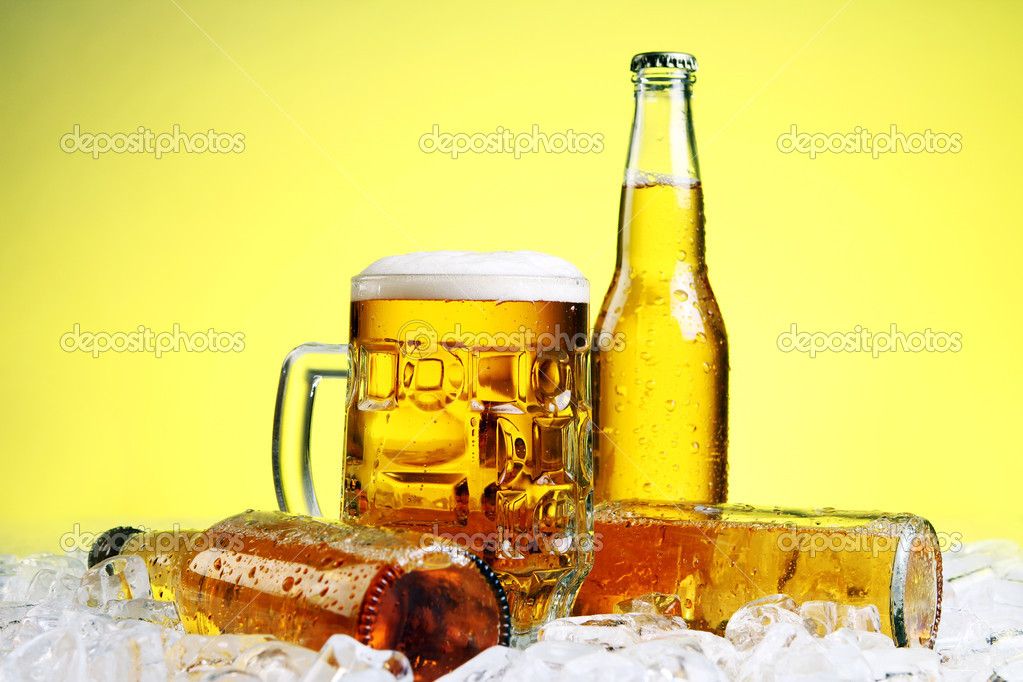 Bottles and Glass of beer with foam over yellow background — Stock Photo #5716640