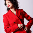 Beautiful young womin red coat — Stock Photo #5841828