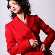 Beautiful young woman in red coat — Stock Photo