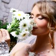 Young bride with flowers — Stock Photo #5841883