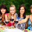 Foto Stock: Group of Young Girls Drinking Wine in Park