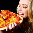Cheerful girl eating pizza — Stock Photo #5841887