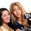 Cheerful girlfriends with photo camera — Stock Photo