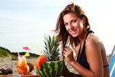 Beautiful Girl Drinking Fruit Cocktail on the Beach — Stock Photo