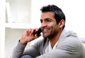 Young man calling by phone — Stockfoto